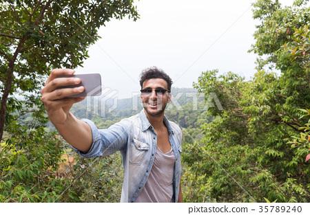 Hispanic Man Take Selfie Photo Over Mountain 35789240