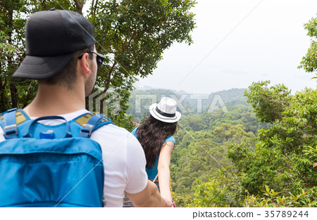 Couple With Backpacks Trekking In Forest Back Rear 35789244