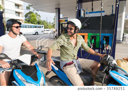 Man Couple On Gas Station Fuel Motor Bike, Happy 35789251