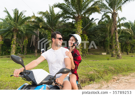 Couple Riding Motorbike, Young Man And Woman 35789253
