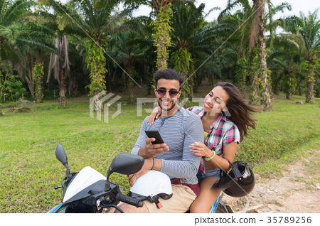 Couple Riding Motorbike, Young Man And Woman Using 35789256