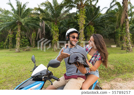Couple Riding Motorbike, Young Man And Woman 35789257