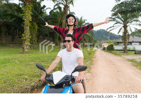 Couple Riding Motorbike, Young Man And Woman 35789258