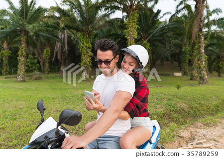 Couple Riding Motorbike, Young Man And Woman Using 35789259