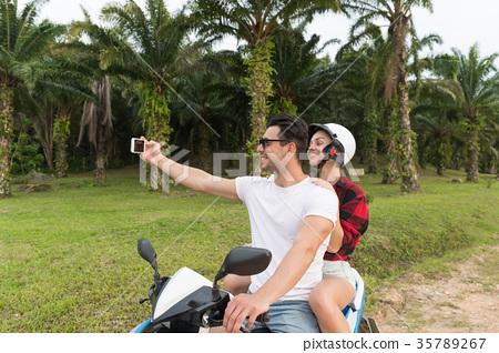 Couple Riding Motorbike, Man And Woman Taking 35789267
