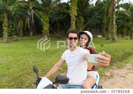 Couple Riding Motorbike, Man And Woman Taking 35789268