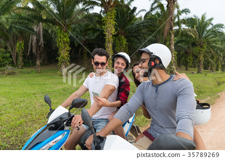 Two Couple Riding Motorbike, Young Man And Woman 35789269