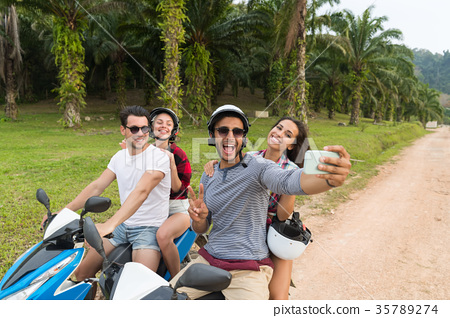 Two Couple Riding Motorbike, Man And Woman Taking 35789274