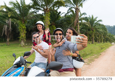 Two Couple Riding Motorbike, Man And Woman Taking 35789279