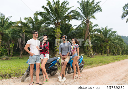 Two Couple Sitting Motorbike, Young Man And Woman 35789282