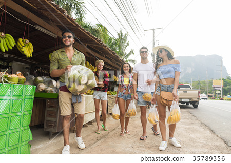 People Group Holding Bananas And Pineapple On 35789356