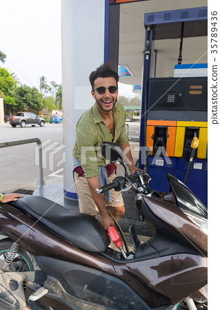 Man Fuel Motor Bike, Happy Smiling Hispanic Guy On 35789436