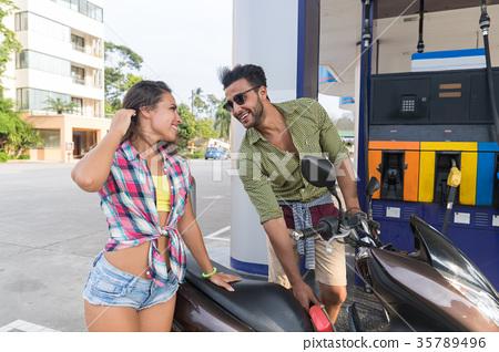 Couple On Gas Station Man Fuel Motor Bike, Happy 35789496
