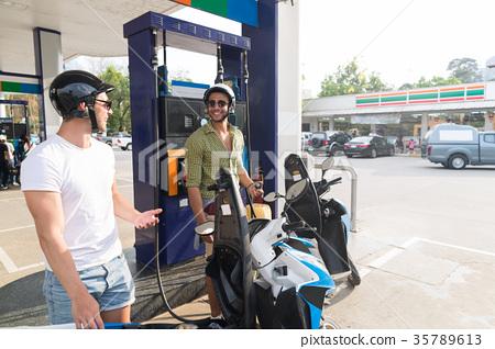 Man Couple On Gas Station Fuel Motor Bike, Happy 35789613