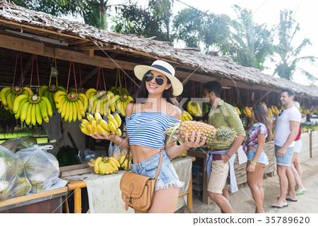 Woman Hold Bananas And Pineapple On Street 35789620