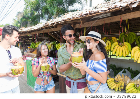 People Group Drink Coconut Cocktail On Street 35789622