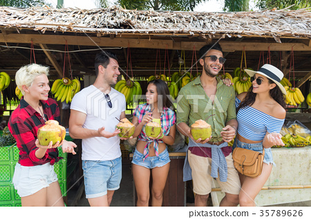 People Group Drink Coconut Cocktail On Street 35789626