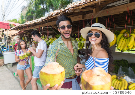 Couple Drink Coconut Cocktail On Street 35789640