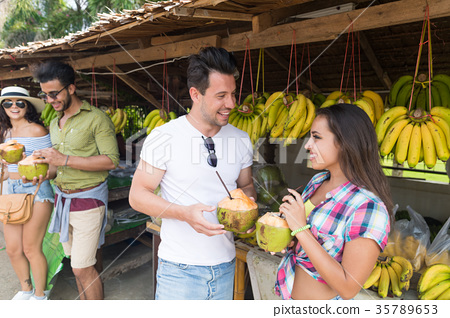 Couple Drink Coconut Cocktail On Street 35789653
