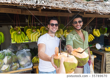 Man Couple Drink Coconut Cocktail On Street 35789670