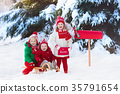 Children with letter to Santa Christmas mail box 35791654