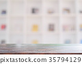Wood desk or table in library with copy space. 35794129