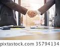 Business Partnership businessman shaking hands. 35794134