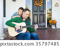 Young Mixed Race Chinese and Caucasian Son Singing Songs and Pla 35797485