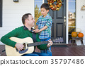 Young Mixed Race Chinese and Caucasian Son Singing Songs and Pla 35797486