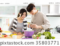 young asian couple cooking in kitchen 35803771