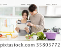 young asian couple cooking in kitchen 35803772