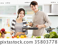 happy young Couple cooking in the kitchen 35803778