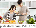 happy young Couple cooking in the kitchen 35803779