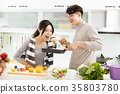 happy young Couple cooking in the kitchen 35803780
