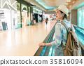 beautiful Asian woman walking around airport 35816094