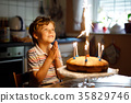 Adorable happy blond little kid boy celebrating 35829746