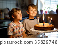 little kid boys twins celebrating birthday and 35829748
