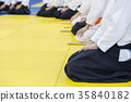 People in kimono on martial arts weapon training 35840182