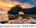 Tanah Lot Temple on sea at sunset in Bali Island 35844963