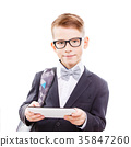 Cute schoolboy in glasses with tablet PC 35847260