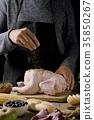 young man preparing a turkey 35850267