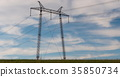 cloudy morning sky and a high-voltage line 35850734