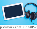 Empty tablet with headphone for Music concept 35874052