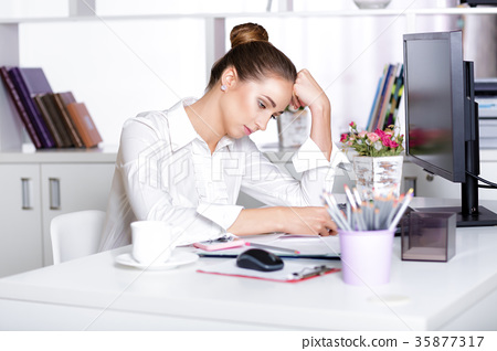 tired woman manager in the office 35877317
