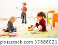 Three kids playing with toys 35886021