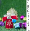 Close up Christmas decoration on grass 35887155