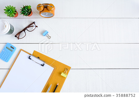 Flat lay office equipment on a white wood desk 35888752