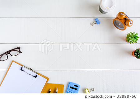 Flat lay office equipment on a white wood desk 35888766