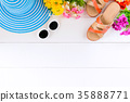 Blue hat sunglasses and shoe on white wood table 35888771