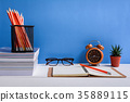 Books Pencil and glasses on a white wooden table  35889115